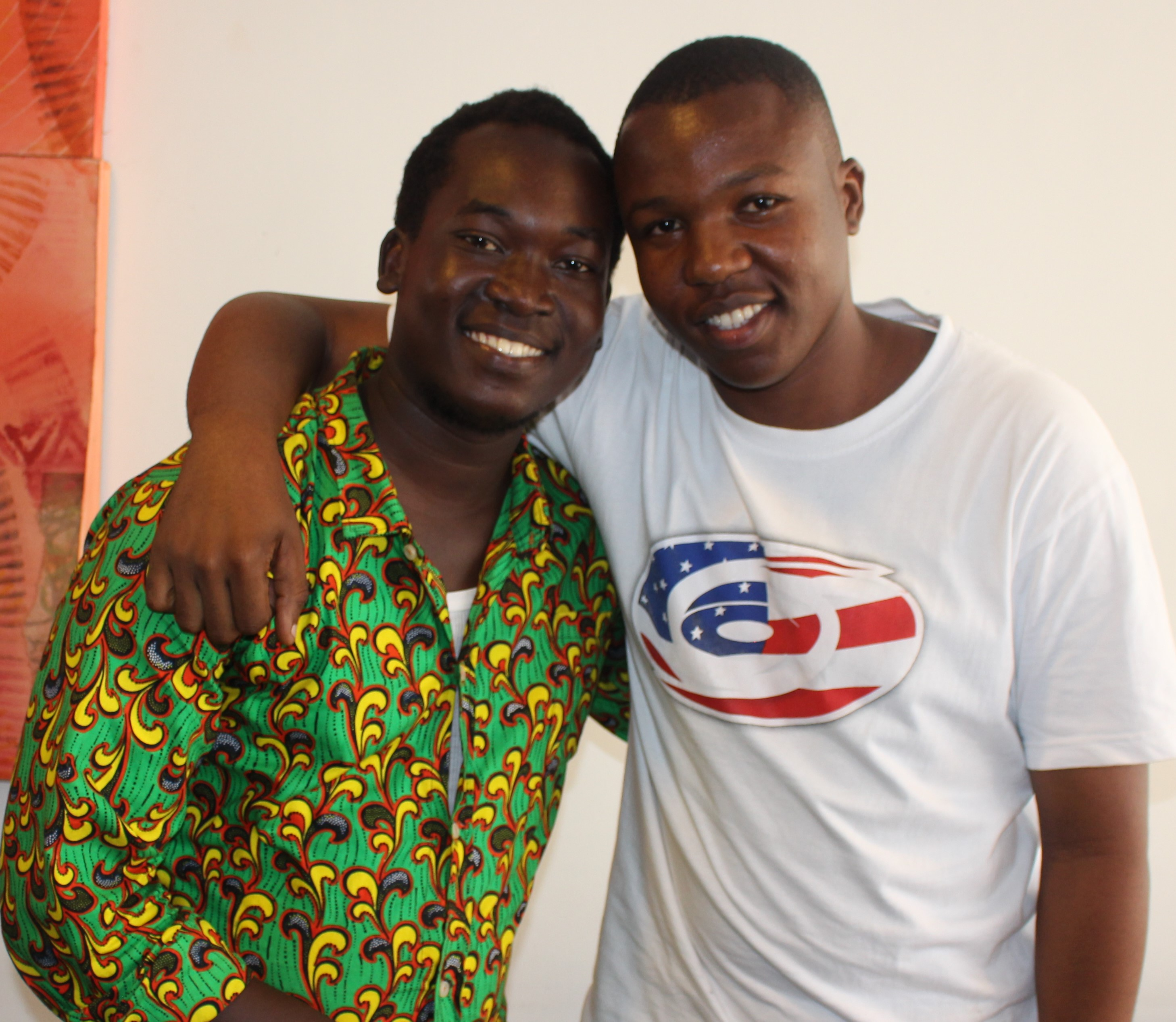 Two A young Tanzanian men smiling at the camera